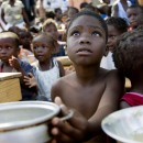 A child awaits for the distribution of meals by WFP (United Nations World Food Programme) in a make-shift camp in Jacmel January 28, 2010. An earthquake on January 12 killed some 200,000 people and devastated the impoverished country.      REUTERS/Marco Dormino/UN/MINUSTAH/Handout     (HAITI - Tags: DISASTER SOCIETY) FOR EDITORIAL USE ONLY. NOT FOR SALE FOR MARKETING OR ADVERTISING CAMPAIGNS
