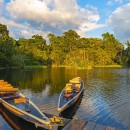 Two traditional wooden canoes at sunset in the Amazon River Basi