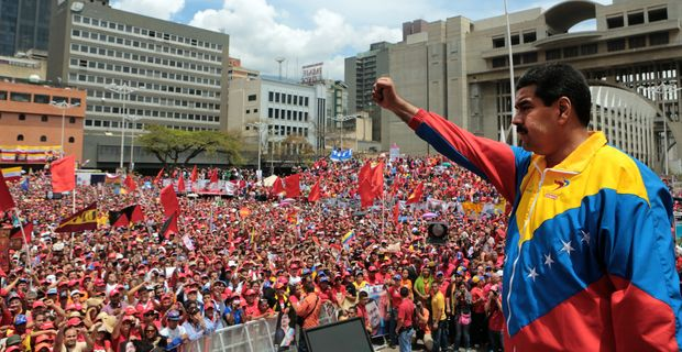 "ORG XMIT: MSN005 Handout picture released by the Venezuelan Presidency showing Venezuela acting President Nicolas Maduro (R) delivering a speech after registering his candidacy for the upcoming presidential election at the National Electoral Council (SNE), in Caracas, on March 11, 2013. Venezuela has entered a bitter election race to succeed Hugo Chavez, with his chosen successor branding his challenger a ""fascist"" after the opposition candidate accused him of exploiting the late leader's death.  AFP PHOTO/PRESIDENCIA/MARCELO GARCIA/HO   --- RESTRICTED TO EDITORIAL USE - MANDATORY CREDIT ""AFP PHOTO/PRESIDENCIA/HO"" - NO MARKETING NO ADVERTISING CAMPAIGNS - DISTRIBUTED AS A SERVICE TO CLIENTS"